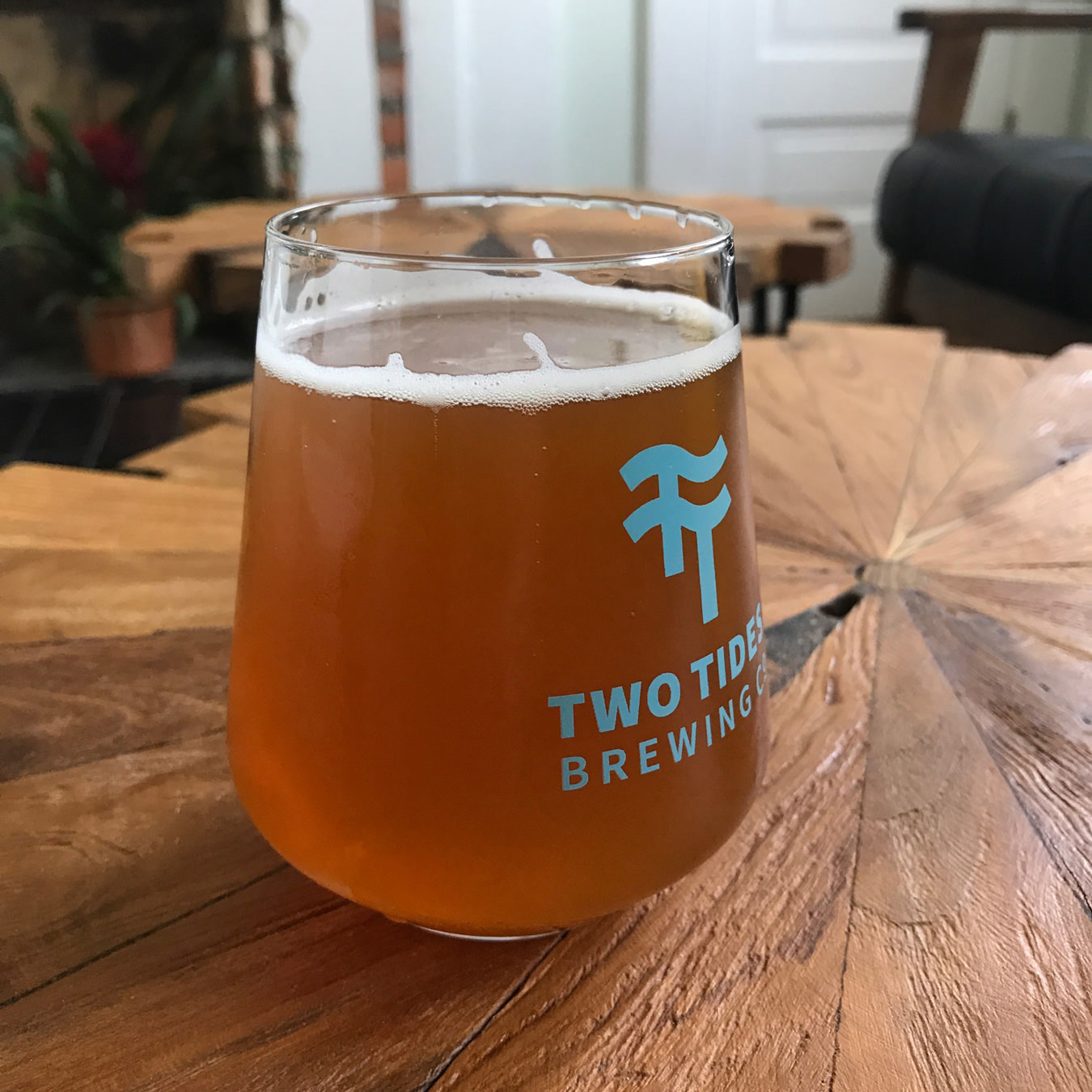 A photograph of the standard Two Tides Brewing Co. glass.