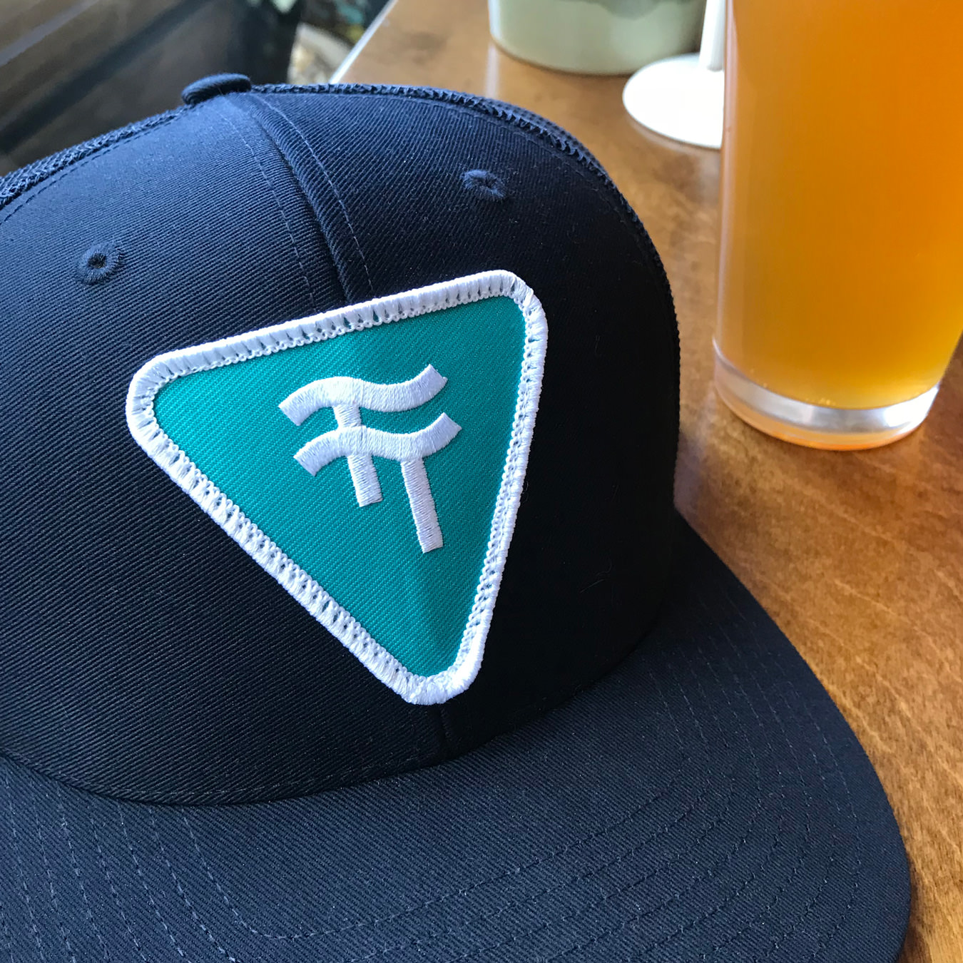 A photograph of a Two Tides Brewing Co. hat.